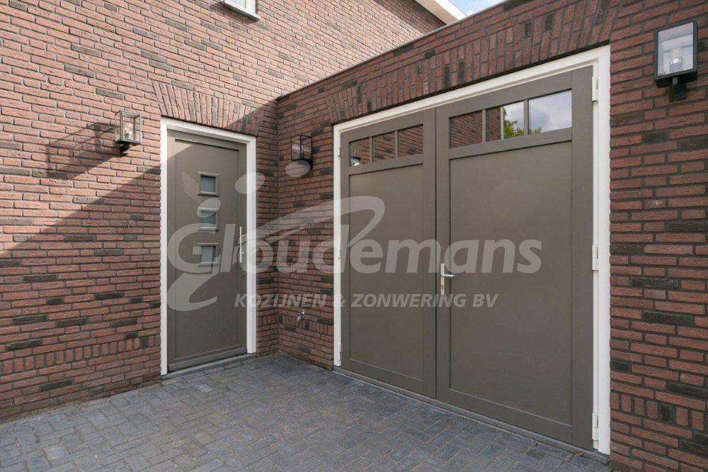 Gloudemans Kozijnen & Zonwering - referentie Rijsbergen - kunststof voordeur en garagedeuren